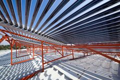 Panels and Pipes of the solar water heater. On the roof Stock Photo