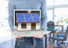 Panels on roof house on laptop. In the office. Digital composite of panels on roof house on laptop. In the office Royalty Free Stock Photo
