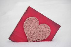 Panels of thread and nails, heart on a red background. string art on a white background. gift or decoration for February 14 and. Panels of thread and nails stock images