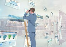 Panels with websites(blue) city background and man on a ladder with binoculars Stock Photo