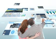 panels with websites(blue) couple looking for it and fingering. Royalty Free Stock Images