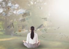 panels with websites flaying and business woman meditating in the park Royalty Free Stock Photography