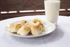 Panes con leche Imagen de archivo libre de regalías