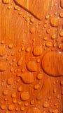 Panes del agua en la madera del grano Fotografía de archivo libre de regalías