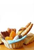 Panes, salchichas y queso con el fondo blanco Imágenes de archivo libres de regalías