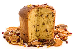 Panettone. Sliced Panettone with dried fruit as closeup on white background Royalty Free Stock Photography
