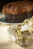 Panettone. Soft turrón cubes with pistachios and panettone in the background Royalty Free Stock Photos