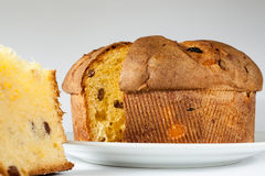 Panettone. Sliced Italian panettone on white background Royalty Free Stock Images