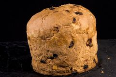 Panettone. A closeup view of a whole loaf or cake of Panettone, a typical sweet bread of Milan, usually prepared and enjoyed for Christmas and New Year around royalty free stock photos