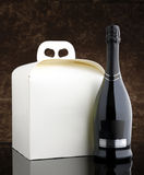 Panettone with bottle of sparkling wine Stock Photos