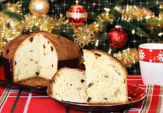 Panettone and Christmas tree Stock Photos