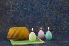 Panettone, easter bread on dark stone table with green linen napkins stock images