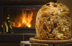 Panettone, fireplace and wine in background Royalty Free Stock Photography