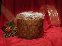 Panettone with golden ribbon and Christmas decoration. Winter holidays theme. Royalty Free Stock Photography