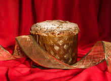 Panettone with golden ribbon. Christmas and New Year theme. Royalty Free Stock Images