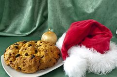 Panettone and hat of Santa Claus Royalty Free Stock Photo