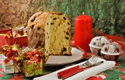 Panettone - Italian xmas cake. Traditional Italian Christmas cake with xmas candle and gifts Royalty Free Stock Photo