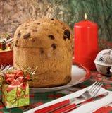 Panettone - Italian xmas cake. Traditional Italian Christmas cake Panettone with xmas candle and gifts Royalty Free Stock Images