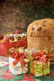 Panettone - Italian xmas cake. Traditional Italian Christmas cake Panettone with xmas gifts Royalty Free Stock Photos