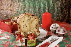 Panettone - Italian xmas cake. Traditional Italian Christmas cake Panettone with xmas candle and gifts Stock Image