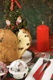 Panettone - Italian xmas cake. Traditional Italian Christmas cake Panettone with xmas candle and gifts Royalty Free Stock Photo