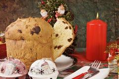 Panettone - Italian xmas cake. Traditional Italian Christmas cake Panettone with xmas candle and gifts Stock Images