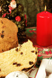 Panettone - Italian xmas cake. Traditional Italian Christmas cake Panettone with xmas candle and gifts Royalty Free Stock Photography