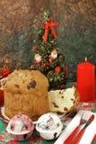 Panettone - Italian xmas cake. Traditional Italian Christmas cake Panettone with xmas candle, tree and gifts Stock Image