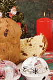 Panettone - Italian xmas cake. Traditional Italian Christmas cake Panettone with xmas candle, tree and gifts Royalty Free Stock Images