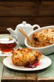 Panettone pudding and fresh black tea on shabby wooden backgroun Stock Image