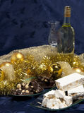 Panettone with wine and Christmas decorations Royalty Free Stock Photos