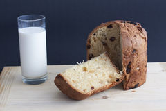 Panettone on a wooden board and milk Royalty Free Stock Photo