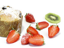 Panettoni with strawberries and kiwi. Panettoni (Italian sort of yeast dough cake) served with strawberries and kiwi stock image