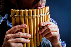 Panflute old played in his hand royalty free stock photos