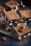 Panforte nero squares . Traditional italian  cake with nuts and Stock Image