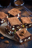 Panforte nero squares . Traditional italian  cake with nuts and Stock Photo