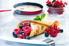 Panfried golden pancake with berries Royalty Free Stock Photography