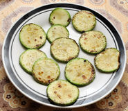 Panfried green zucchini Stock Images