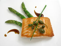 Panfried salmon with asparagus. And capers stock photos