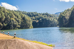 PANG OUNG, MAE HONG SON, Thailand. Pang Oung is a pretty and serene lake in a valley glittering with sunlight surrounded by mountain ranges. The area has an Royalty Free Stock Photography