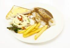 Pangasius鱼排菜沙拉与油煎的法语的多士面包 库存照片