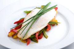 Pangasius Filet. Fried Pangasiusfilet on Paprika with chive Royalty Free Stock Photos
