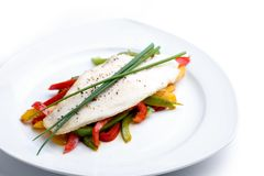 Pangasius Filet. Pangasiusfilet on Paprika with chive and pepper Stock Images