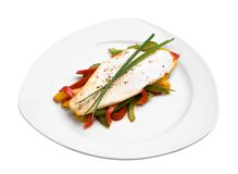 Pangasius Filet. Pangasiusfilet on Paprika with chive and pepper Royalty Free Stock Images