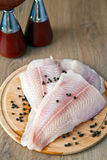 Pangasius Fillet And Black Pepper Royalty Free Stock Photos