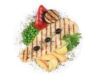 Pangasius fillet grilled with vegetables. Stock Image