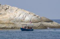 PANGKOR EILAND, MALEISIË - 17 DECEMBER 2017: toerist die strand van activiteiten en terugkeer van eiland genieten die door boot h Royalty-vrije Stock Afbeelding