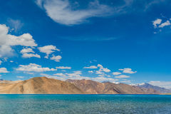Pangong Lake in Ladakh,India. Pangong Tso, Tibetan for long, narrow, enchanted lake, also referred to as Pangong Lake, is an endorheic lake in the Himalayas Stock Image