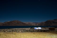 Pangong lake with mountains view and stars in the sky at nighttime. Landscape image of Pangong lake with mountains view and stars in the sky at nighttime stock photos