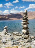 Pangong Tso mountain lake panorama with Buddhist stupas in forefront. (Ladakh, India royalty free stock image